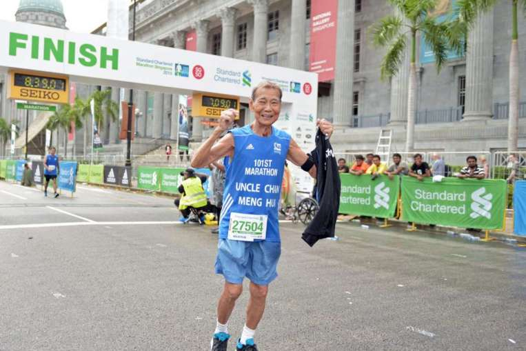 Uncle Chan crosses the finish line. (Photo by Straits Times)