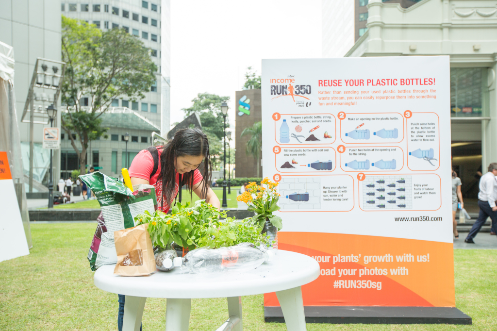 In the process of planting seeds into a plastic bottle. (Credit: RUN350).