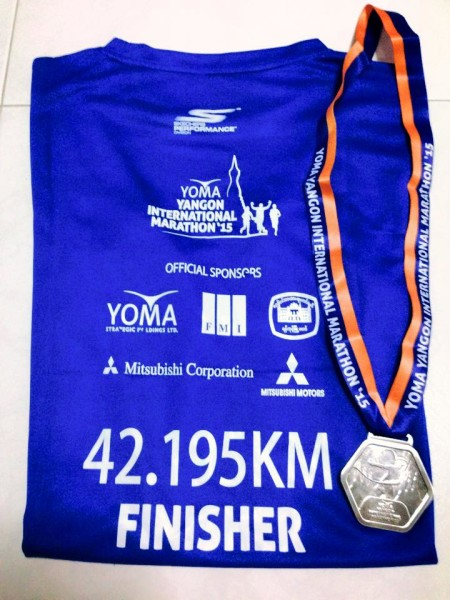 Xiuyi's finisher tee and medal for the Yoma Yangon International Marathon. (Image: Just Run Lah)