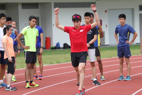 Soh demonstrates a warm-up exercise. Source: Wings Athletics Club.
