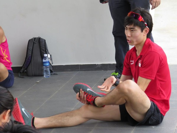 Soh Rui Yong demonstrates a cooling down exercise. Source: Wings Athletics Club.