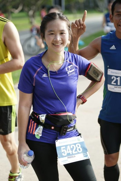 Putting up a smile for the camera, along the race route. (Credit: Pixellated).