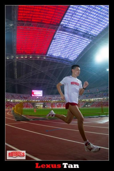 Running around the new National Stadium's track.