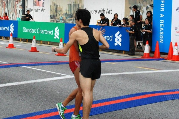 Soh and Liew hug each other as a form of congratulation.