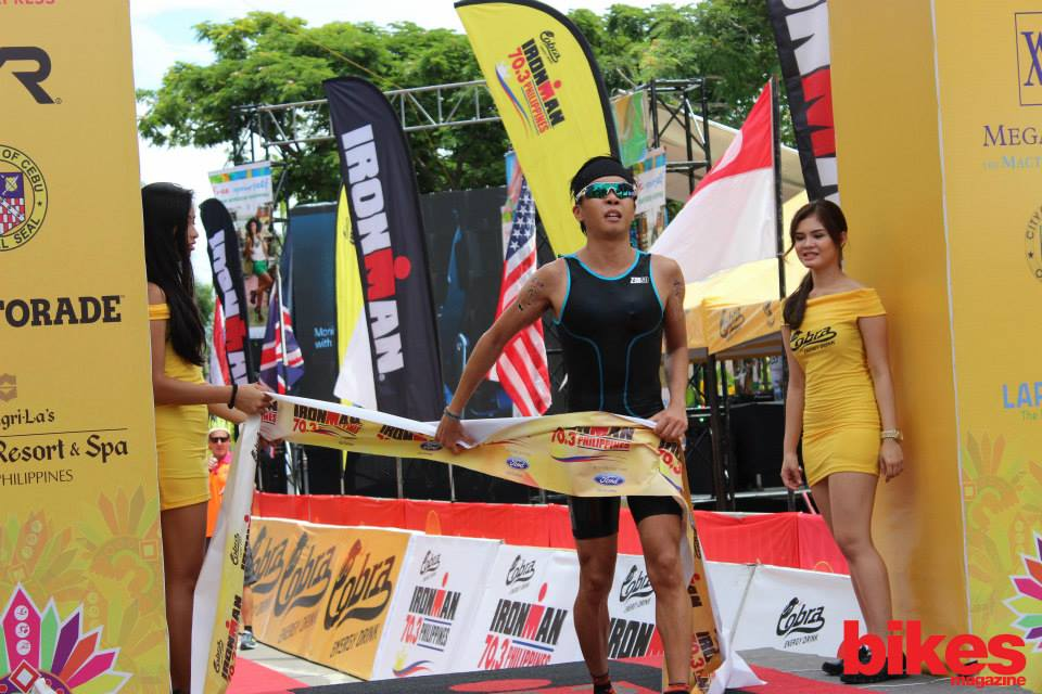 Crossing the finishing line at one of his first few pro races - the Cobra Ironman 70.3 Philippines. (photo credit to Bikes)