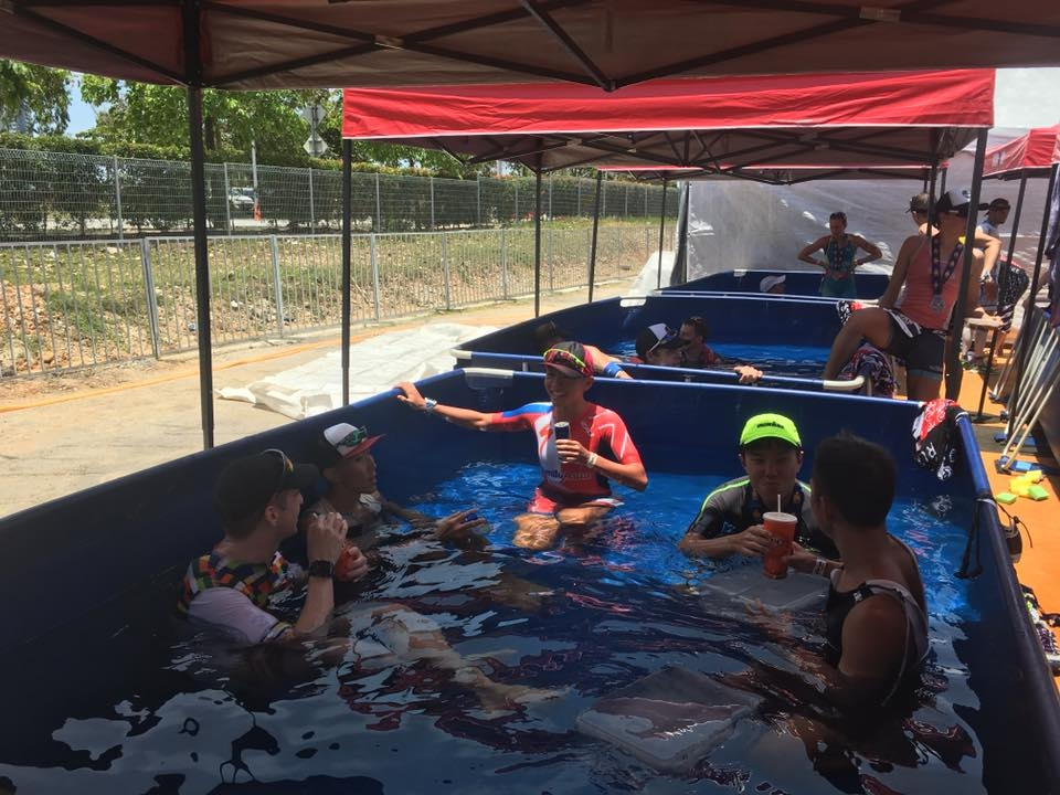 Ling [3rd from left] relaxes in an ice bath after a race. [Photo: Facebook/Ling Er Choo]