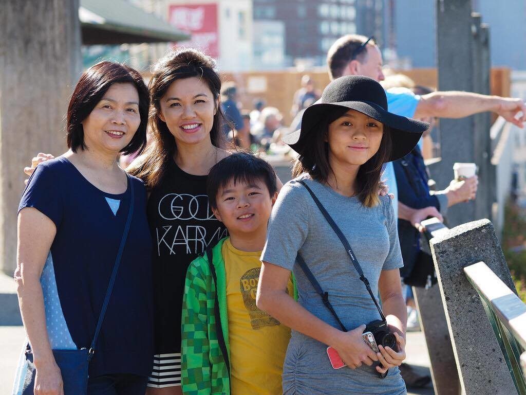 From left to right - Jenny's mom Sue Huang, Jenny Huang, and her children - Austin, 12 and Zoe, 15.