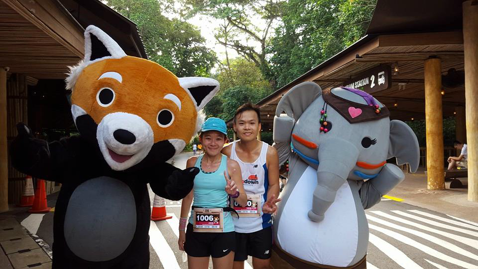 Justina (left) and her friend with the animal mascots. [Photo credit to Justina]