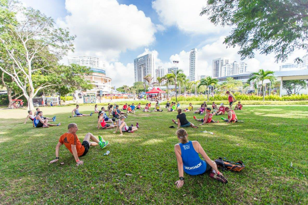 Runners cool down on the grass. [Photo Credit to OSIM Sundown Marathon]