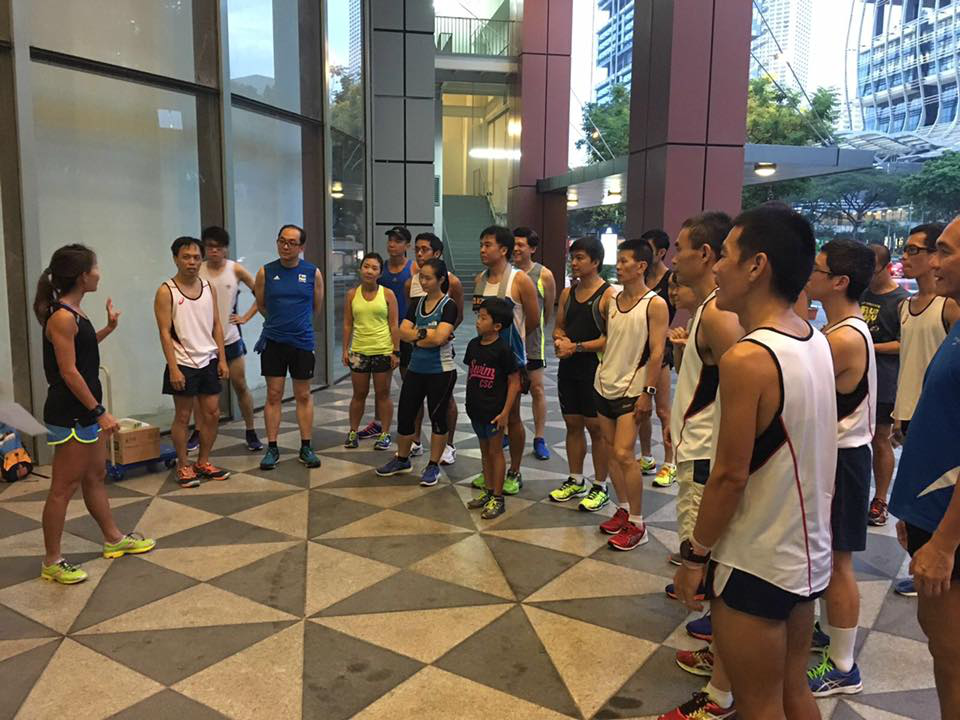 Participants listening to Dr Lim (left, in black) share tips. [Photo by ASICS running club]