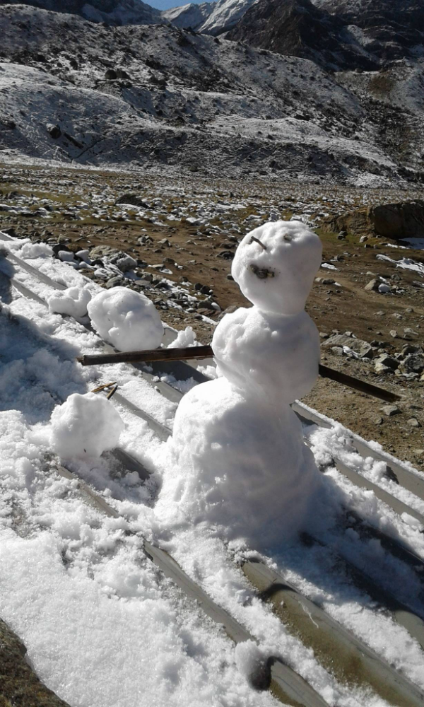 Shariff has a bit of fun making a snowman.
