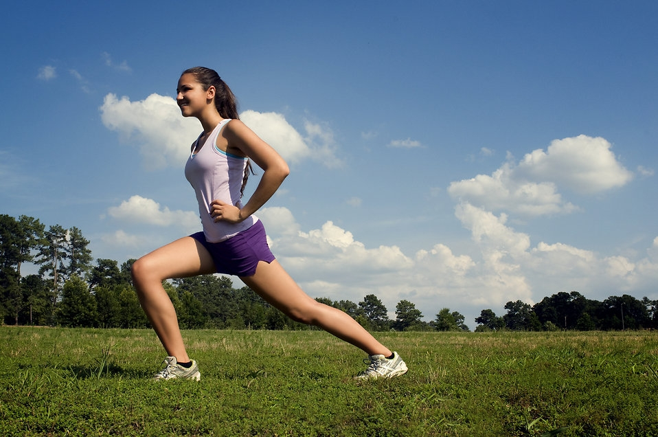 Stretching is useful for runners. [Photo from CDC/ Amanda Mills]