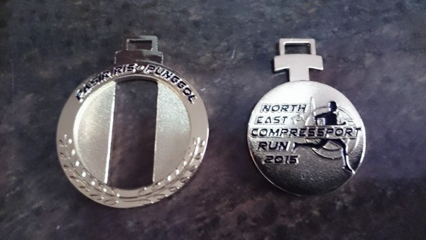The two halves of the unique race medal. (Photo: Edmond Choo)