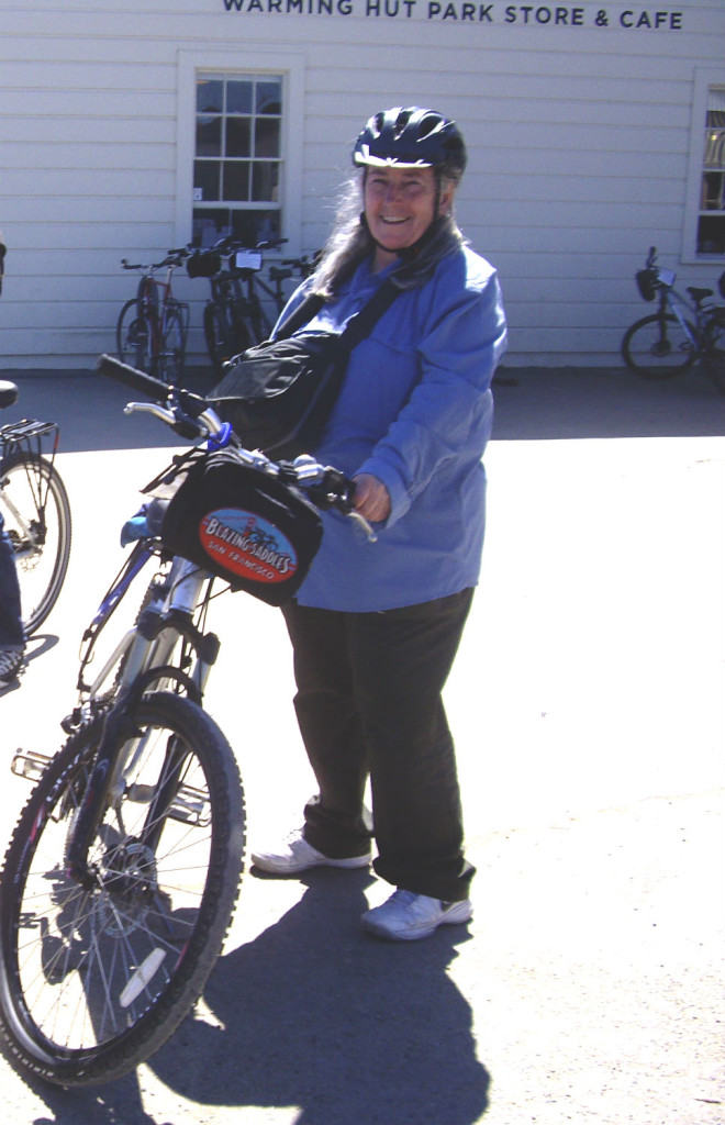 Liz Stewart, two months before her cancer diagnosis - on a bike ride over the Golden Gate Bridge.