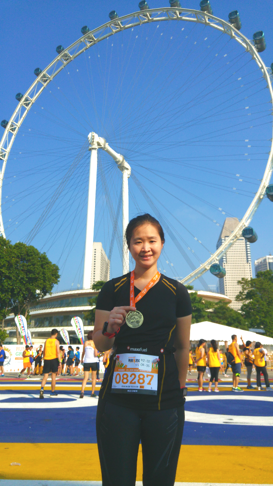 With my race medal and the lovely Singapore Flyer in the background.