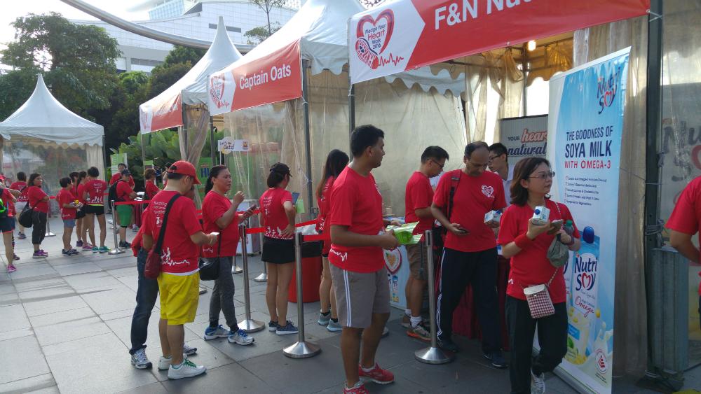 Participants queuing for samples of Marigold milk.