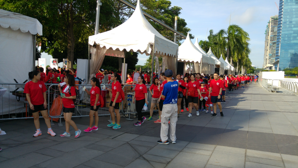 Walkers queuing for their finisher medals.