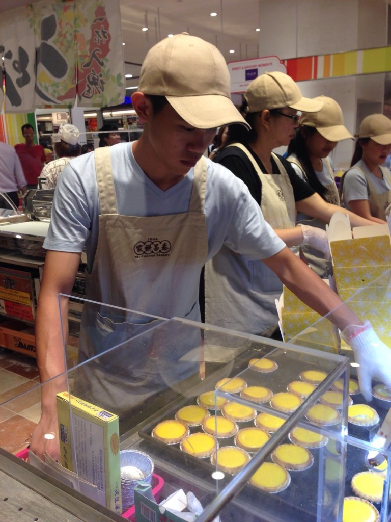 Producing egg tarts for hungry Singaporeans is hard work.