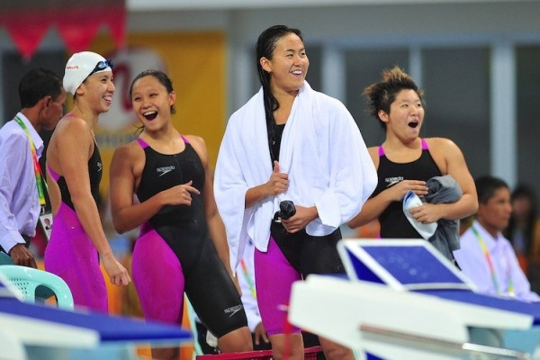 Amanda Lim (extreme left), Samantha Yeo, Quah Ting Wen and Tao Li, after the 4x100m medley relay.