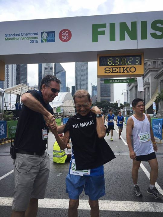 Chan was presented with a special '101 Marathons Finisher' tee shirt. (Photo by Straits Times)