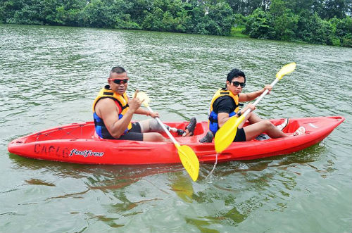 The Singapore Blade Runner (left) takes up canoeing for the day.