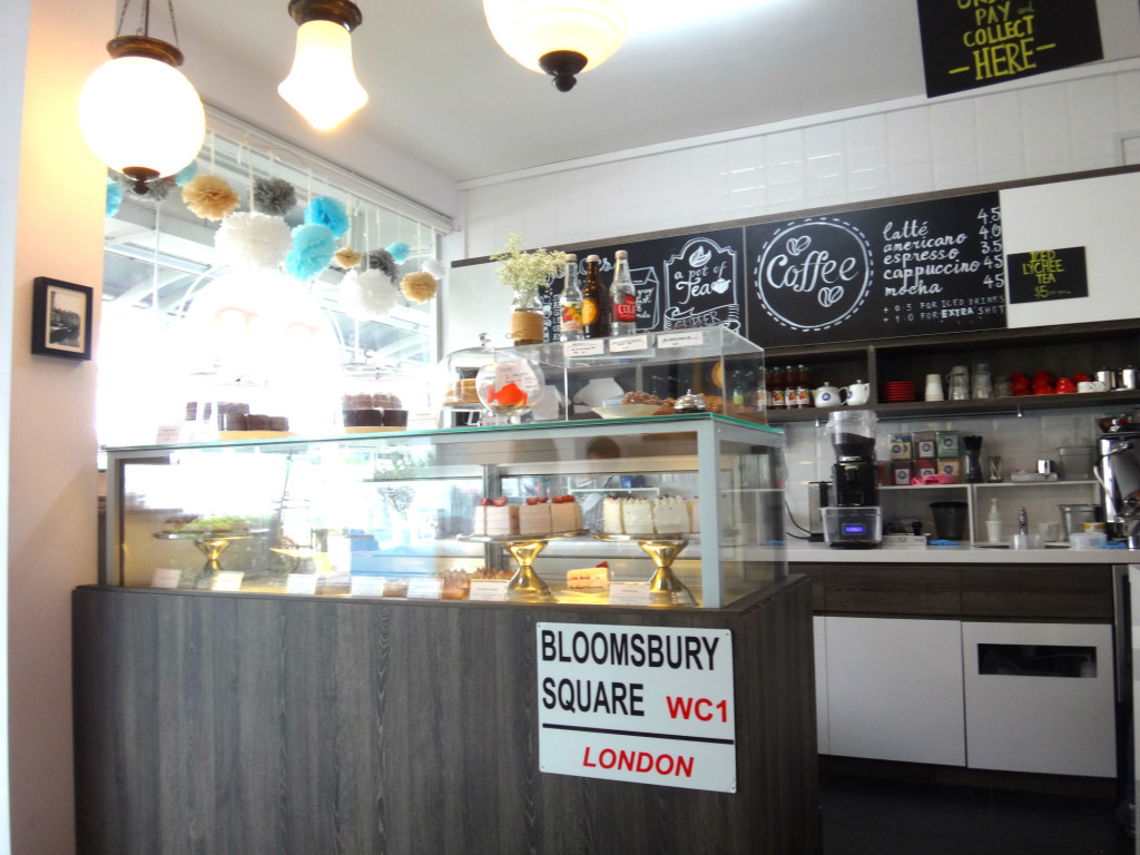 A glass cabinet full of cakes greets you at Bloomsbury Bakers.