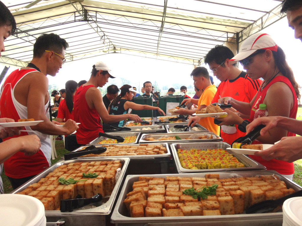 Runners tuck into some food.