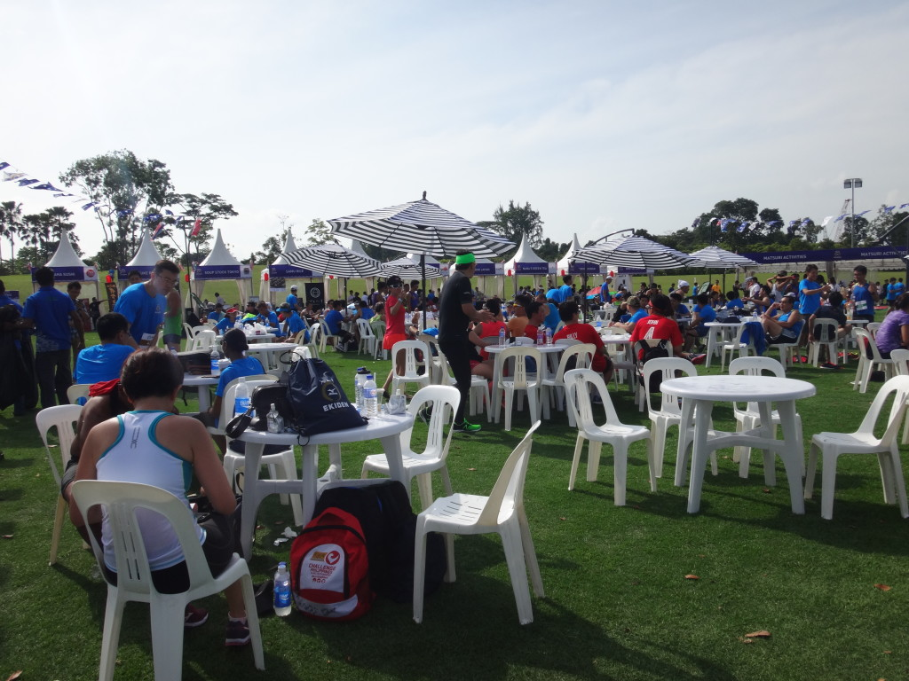 Runners lounging around on chairs at the race village.
