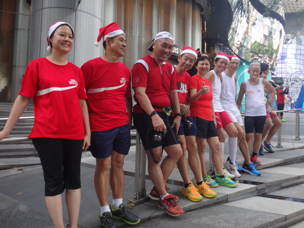 Runners taking a well-earned rest after their run - at ION Orchard Mall.