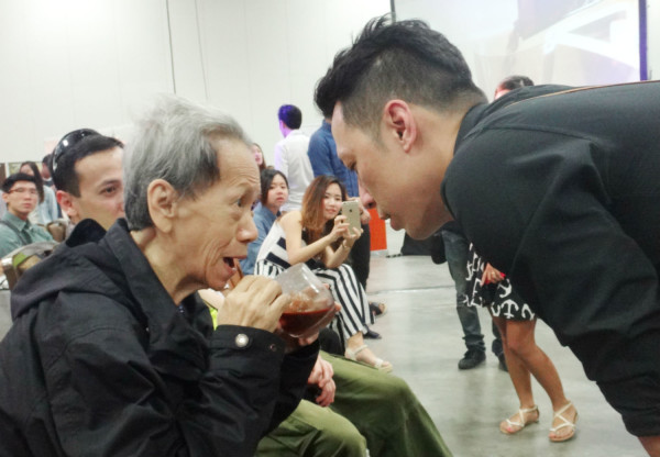 Ting's mother, who is battling end-stage lung cancer, tries a sip of his signature coffee.