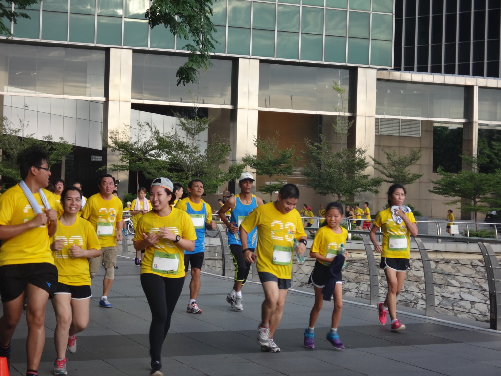 Runners head past the NTUC Building in Raffles Place.