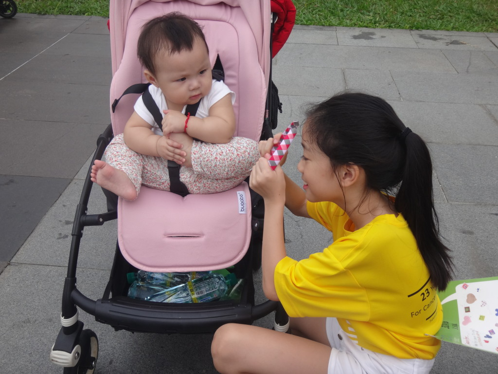 A young girl shares some bonding time with her baby sibling.