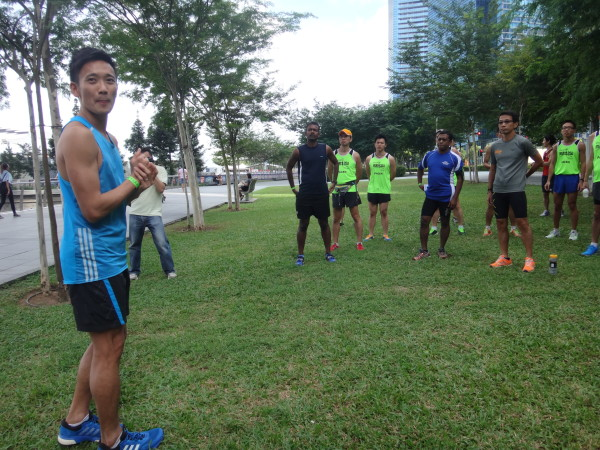 Melvin Wong prepares to give runners practical tips on how to warm up before races.