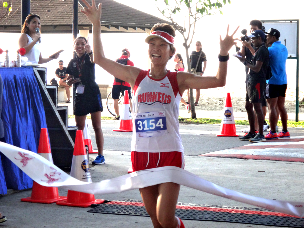 The smile on this girl's face says it all, as she crosses the finish line.