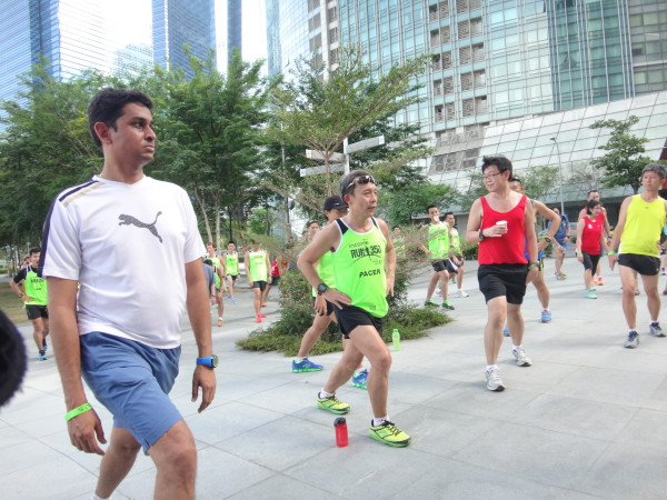 Runners participate in some cool-down exercises, conducted by Lim.