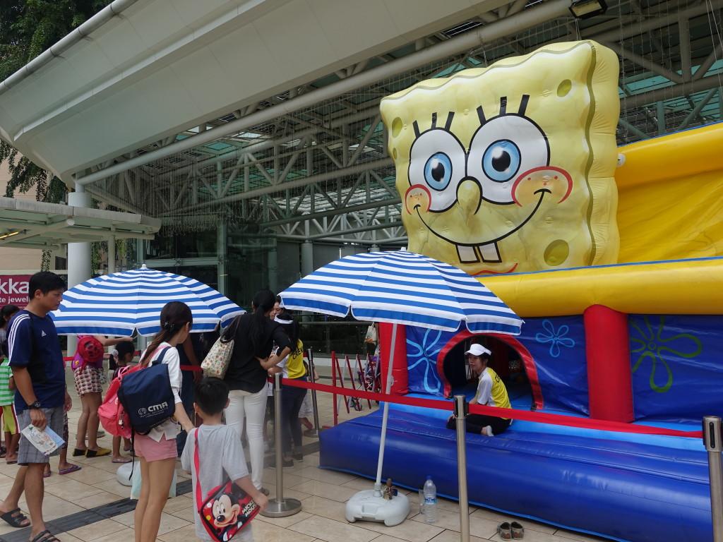Families queue up at the gigantic Spongebob bouncy castle.