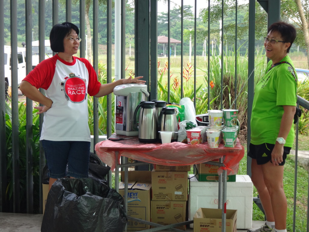 Volunteers manning the instant noodle and hot drink station.