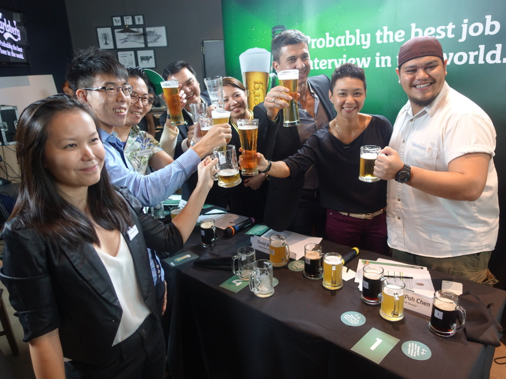 Contestants and judges say 'cheers' over a beer.
