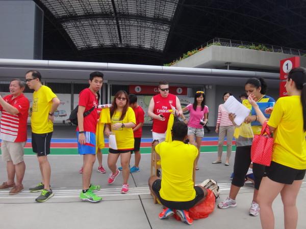 Runners standing around.