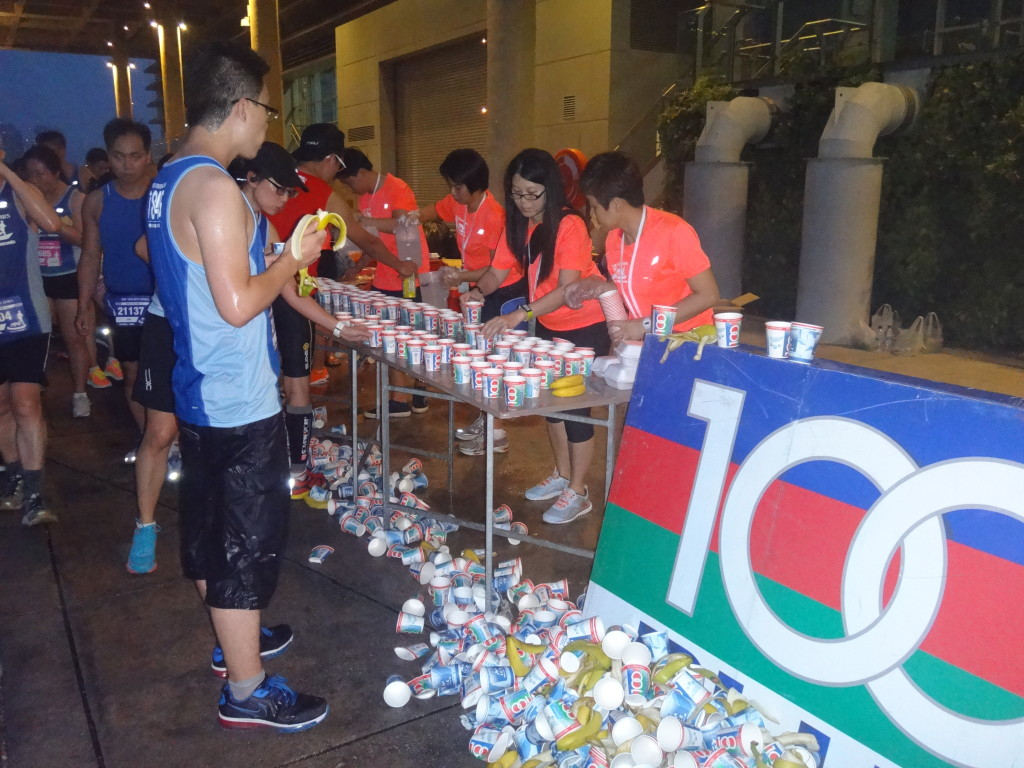 Runners hydrate themselves during the run.