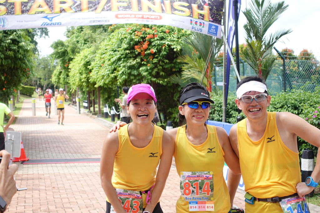 Tired runners pose for a photo in between loops.