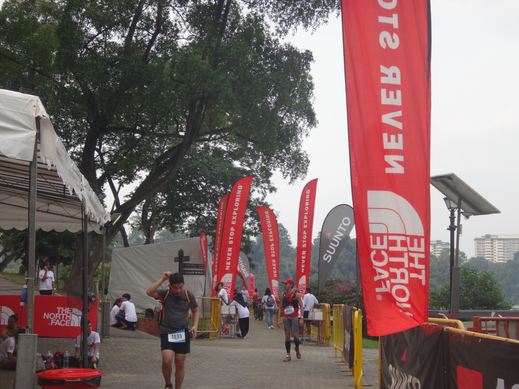 50KM runners passing through the finishing point.