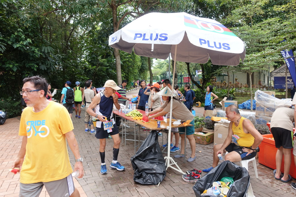 Runners making full use of the aid station.
