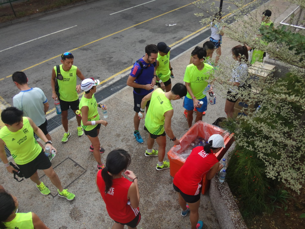 Runners and pacers help themselves to drinks after the session.