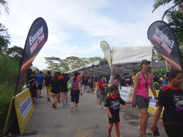 The Energiser Night Trail Run race village is a hive of activity.