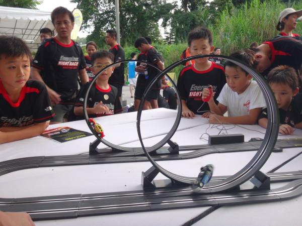 Kids looking at a model car display.