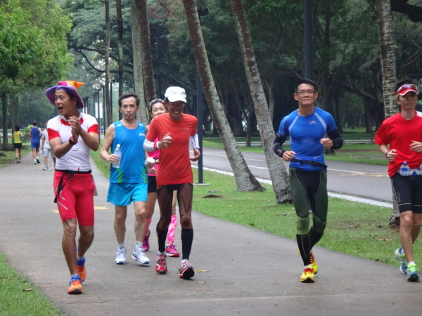 Yong (in blue) and Lim (in orange) are determined to complete their daily 50km runs.