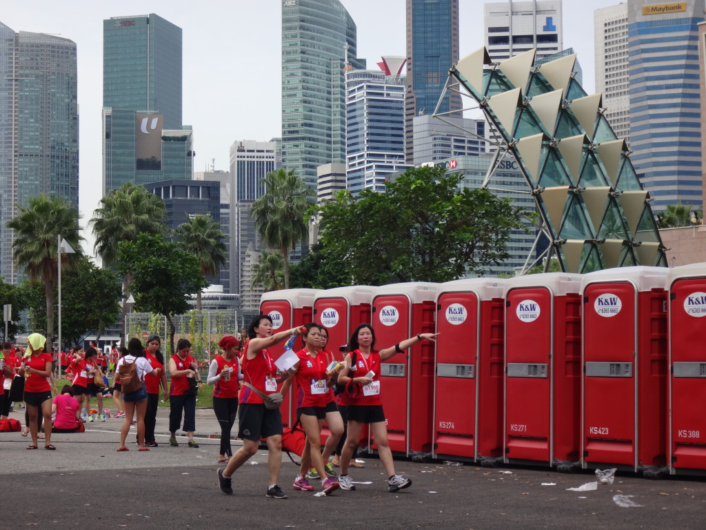 Runners walk past the portable toilets.