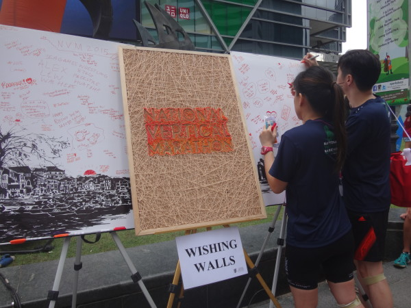Writing their well-wishes for Singapore at the post-event carnival.