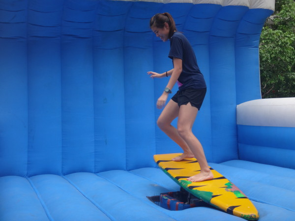 A participant tries out the surfing simulator.